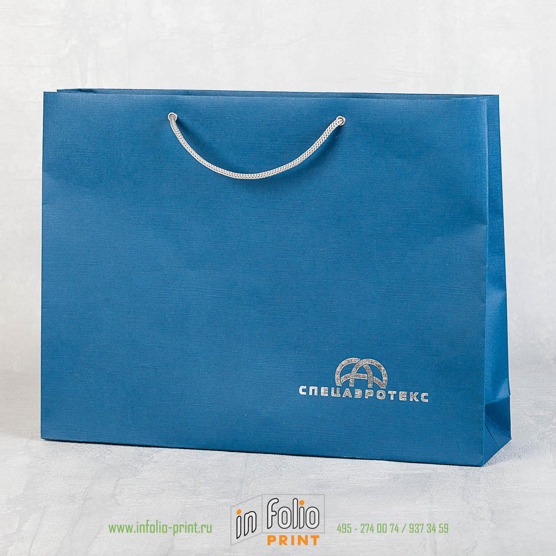Пакет из синего эфалина с серебрянным тиснением горизонтальный