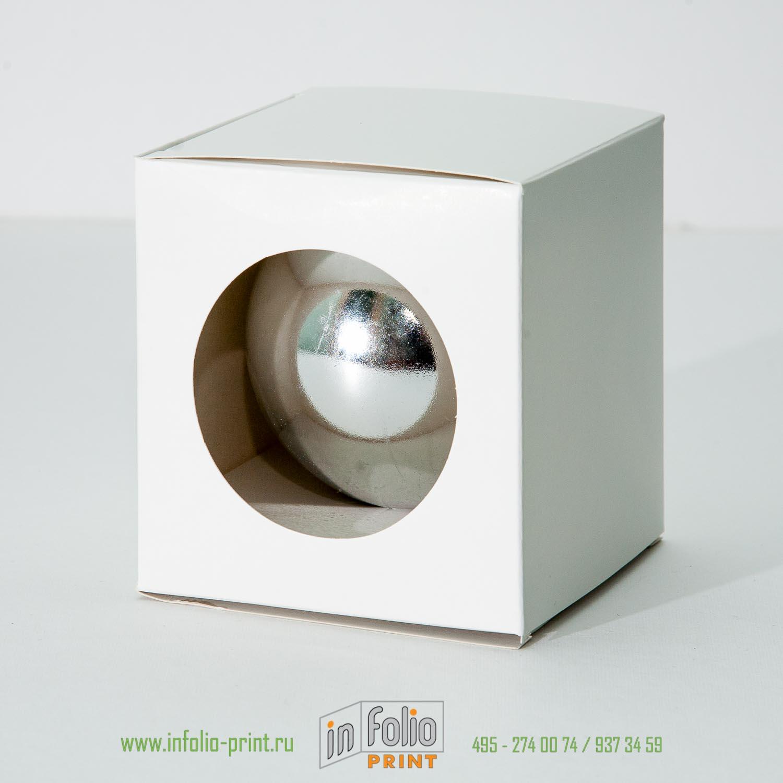 Упаковка из картона под елочный шар