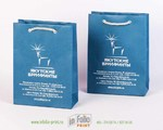 Изготовление бумажных пакетов из дизайнерской бумаги с печатью серебром