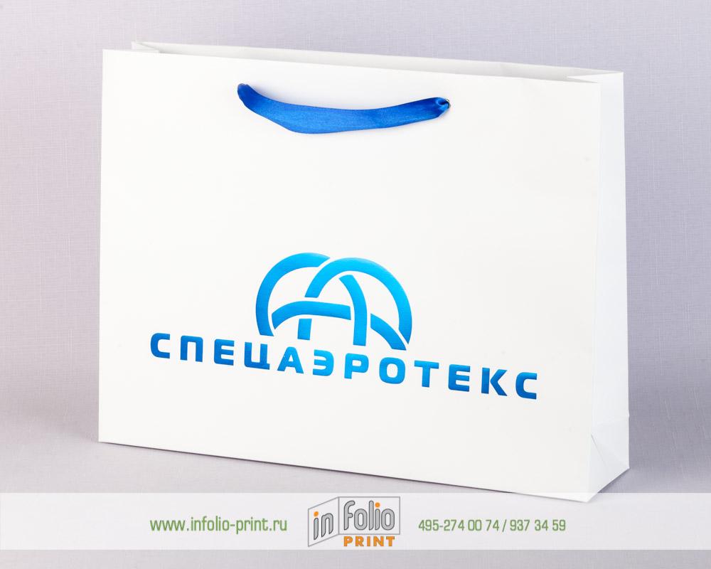Пакет с тиснением голубой фольгой и синими атласными лентами