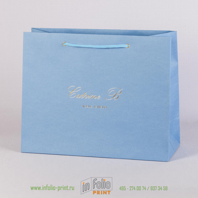 Бумадный пакет с золотым тиснением из голубого льна